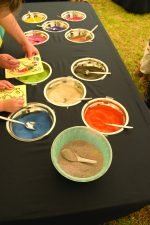 TABLE of COLOURED SAND SET UP