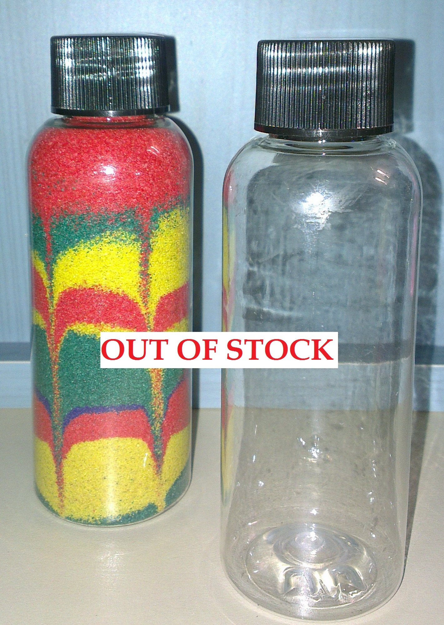 SMALL PLASTIC BOTTLE with BLACK CAP out of stock